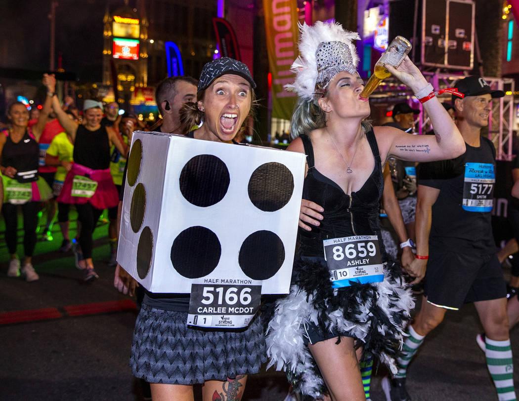 Carlee McDot, left, and Ashley Chroninger celebrate their half marathon finish during the Las V ...