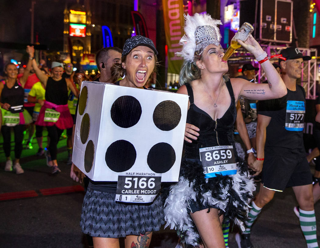 Carlee McDot, left, and Ashley Chroninger celebrate their half marathon finish during the Las V ...