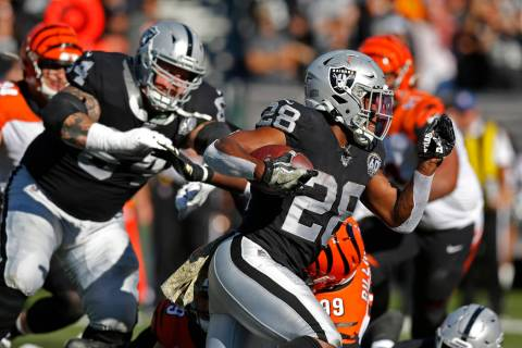 Oakland Raiders running back Josh Jacobs carries the ball during the first half of an NFL footb ...