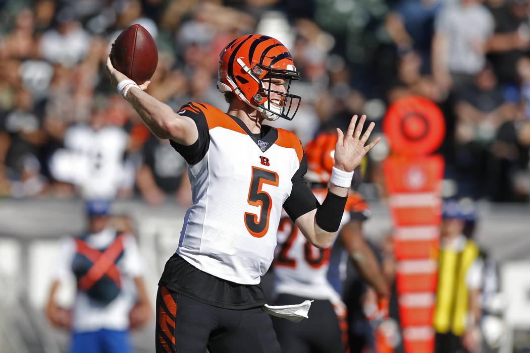 Cincinnati Bengals quarterback Ryan Finley throws during the first half of an NFL football game ...