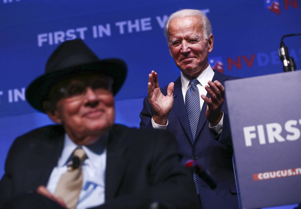 Democratic presidential candidate and former Vice President Joe Biden, right, claps as former U ...