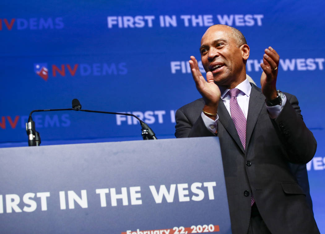 Democratic presidential candidate and former Massachusetts Gov. Deval Patrick claps during the ...