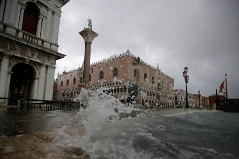 Water starts coming in as the city awakes, in Venice, Italy, Sunday, Nov. 17, 2019. Venetians a ...