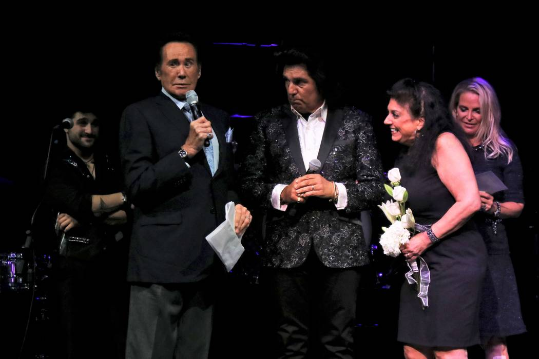 Vinny and Carol Adinolfi renew their vows Thursday with the help of Wayne Newton, left, at Mat ...