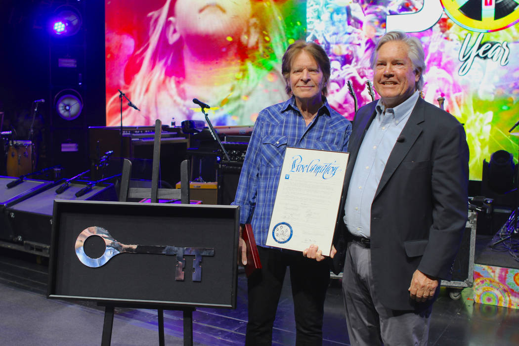 Rock legend John Fogerty and Clark County Commissioner Tick Segerblom are shown at Encore Theat ...