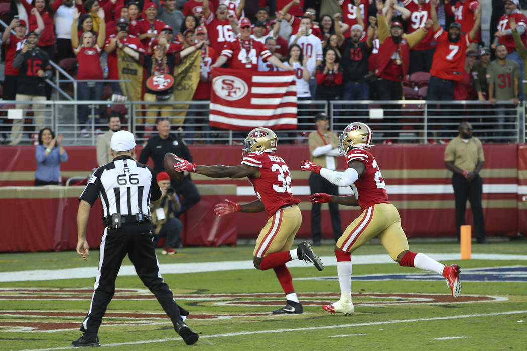 San Francisco 49ers free safety D.J. Reed Jr. (32) returns a fumble to score against the Arizon ...