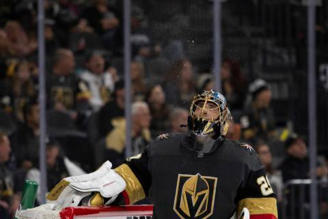 Golden Knights goaltender Marc-Andre Fleury (29) spits water during the third period of the gam ...