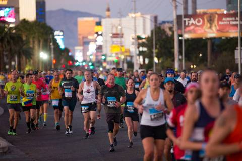 Runners make their way south on the Strip for the Rock 'n' Roll Marathon in Las Vegas, Sunday, ...