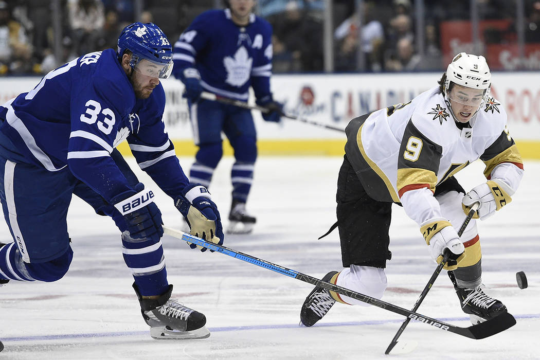 Vegas Golden Knights centre Cody Glass (9) and Toronto Maple Leafs center Frederik Gauthier (33 ...