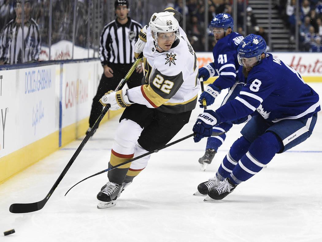 Vegas Golden Knights defenseman Nick Holden (22) moves around Toronto Maple Leafs defenseman Ja ...