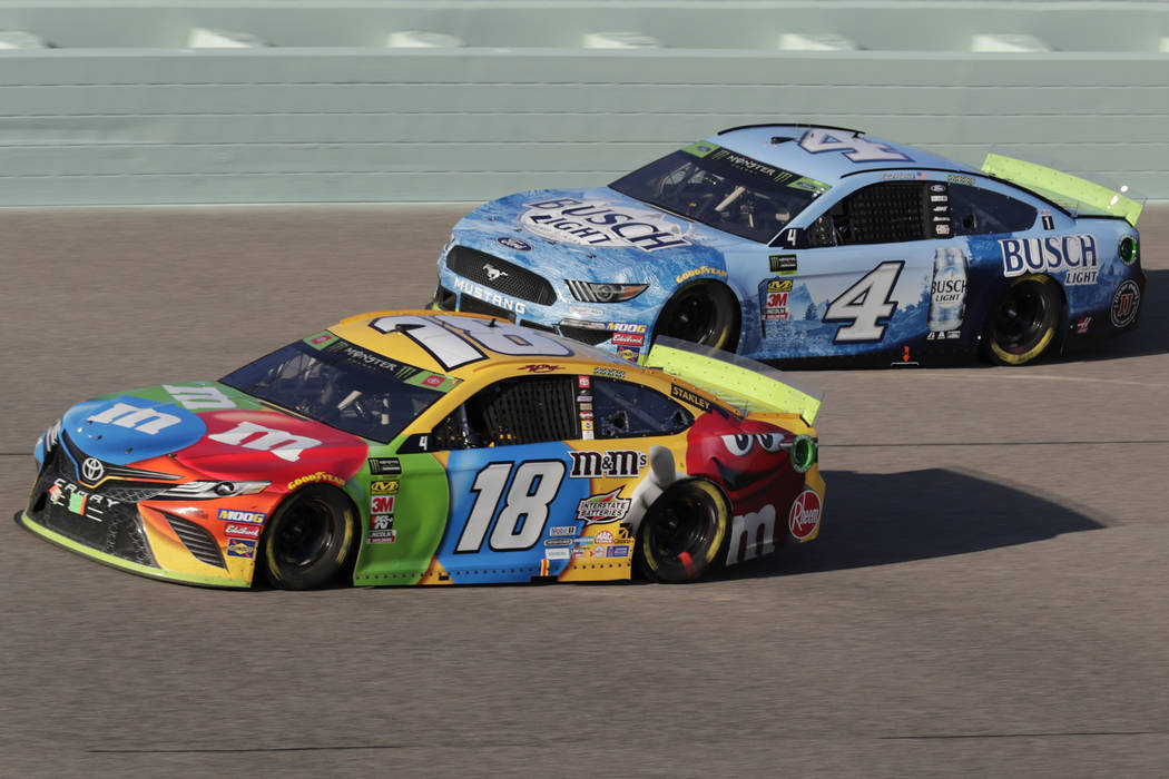 Kyle Busch (18) and Kevin Harvick (4) are seen during the NASCAR Cup Series auto racing season ...