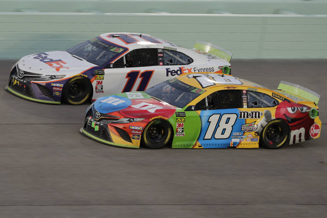 Kyle Busch (18) and Denny Hamlin (11) are seen during the NASCAR Cup Series auto racing season ...