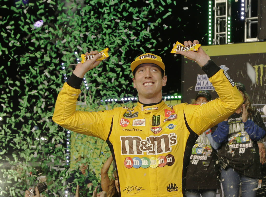 Kyle Busch celebrates in Victory Lane after winning a NASCAR Cup Series auto racing season cham ...