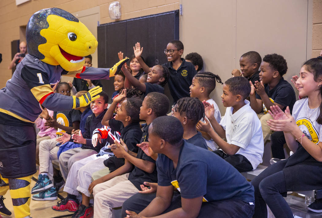 Chance the Gila monster greets kids at the Doc Pearson Community Center as Vegas Golden Knights ...