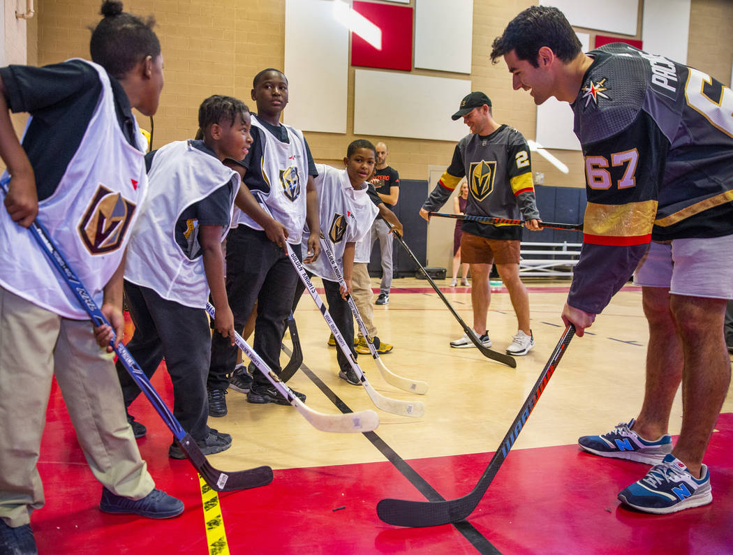 Vegas Golden Knights forwards Paul Stastny, center, and Max Pacioretty work on stick handling w ...
