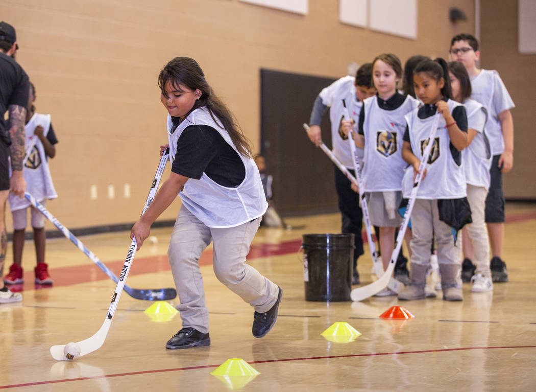 Solanch Ramirez, 8, drives during a puck handling drill as Vegas Golden Knights forwards Max Pa ...