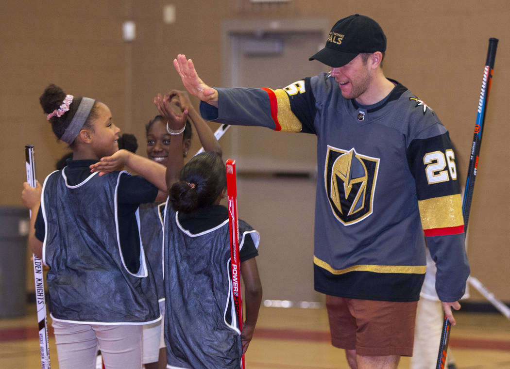 Vegas Golden Knights forward Paul Stastny celebrates a goal by his team as he and teammate Max ...