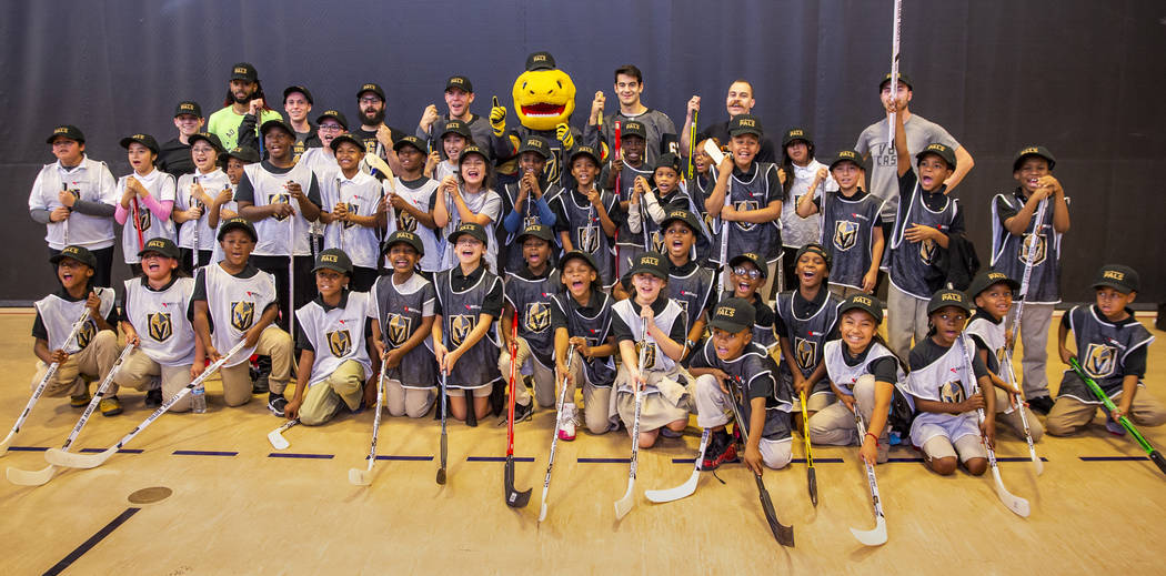 Vegas Golden Knights forwards Max Pacioretty and Paul Stastny with Chance the Gila monster pose ...