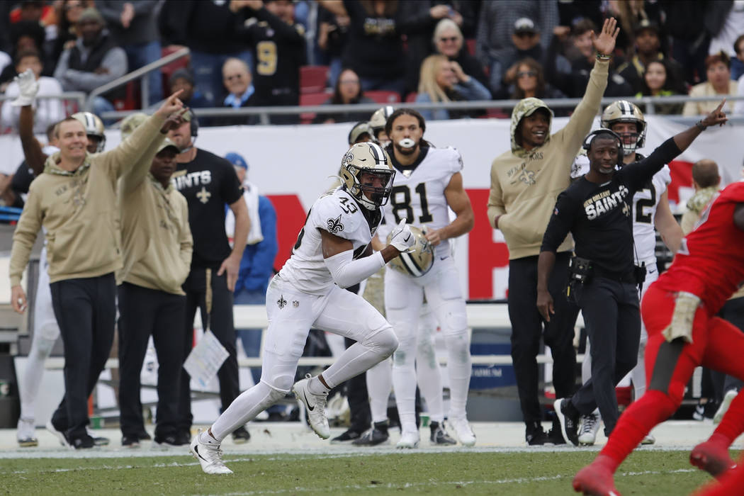 New Orleans Saints free safety Marcus Williams (43) runs an interception by Tampa Bay Buccaneer ...
