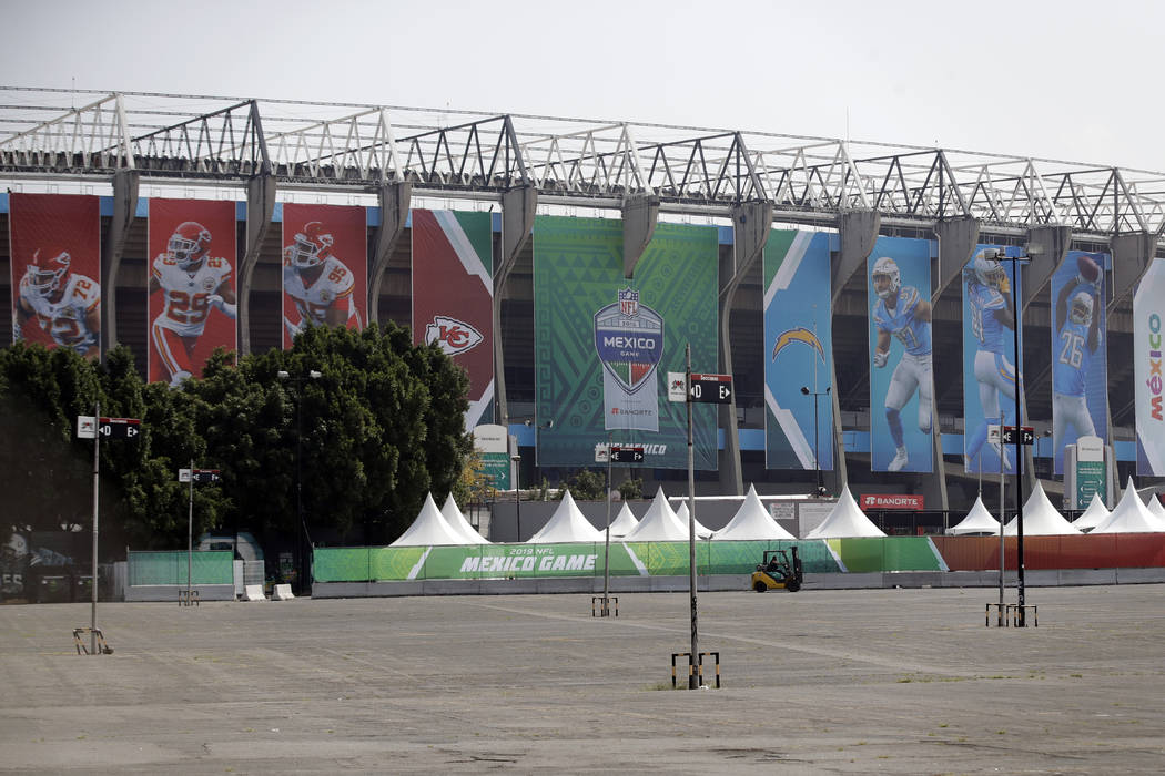 Banners showing players from the Los Angeles Chargers and the Kansas City Chiefs hang from Azte ...