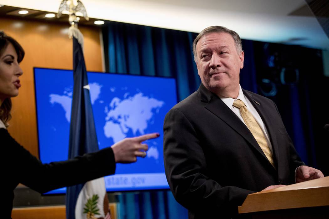 Secretary of State Mike Pompeo, right, pauses as State Department spokeswoman Morgan Ortagus, l ...