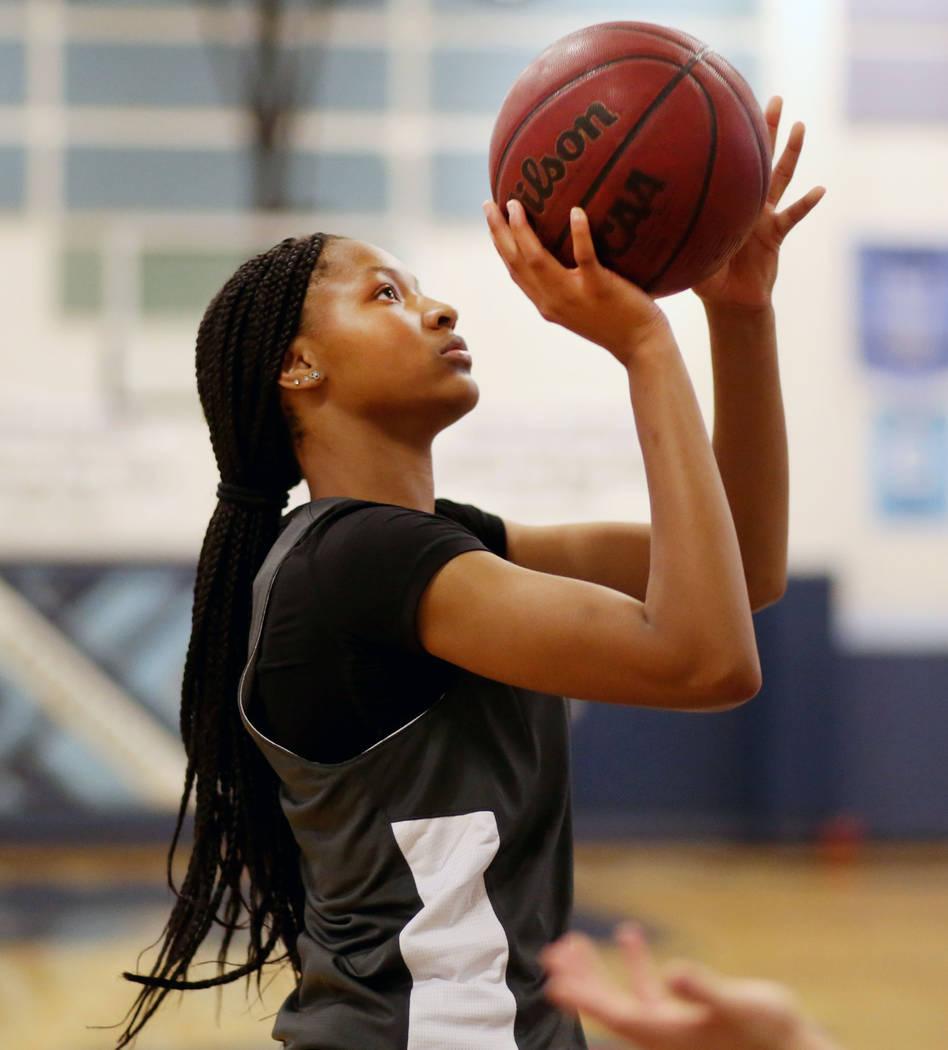 Centennial junior Taylor Bigby, shoots a basket during varsity practice at Centennial high scho ...