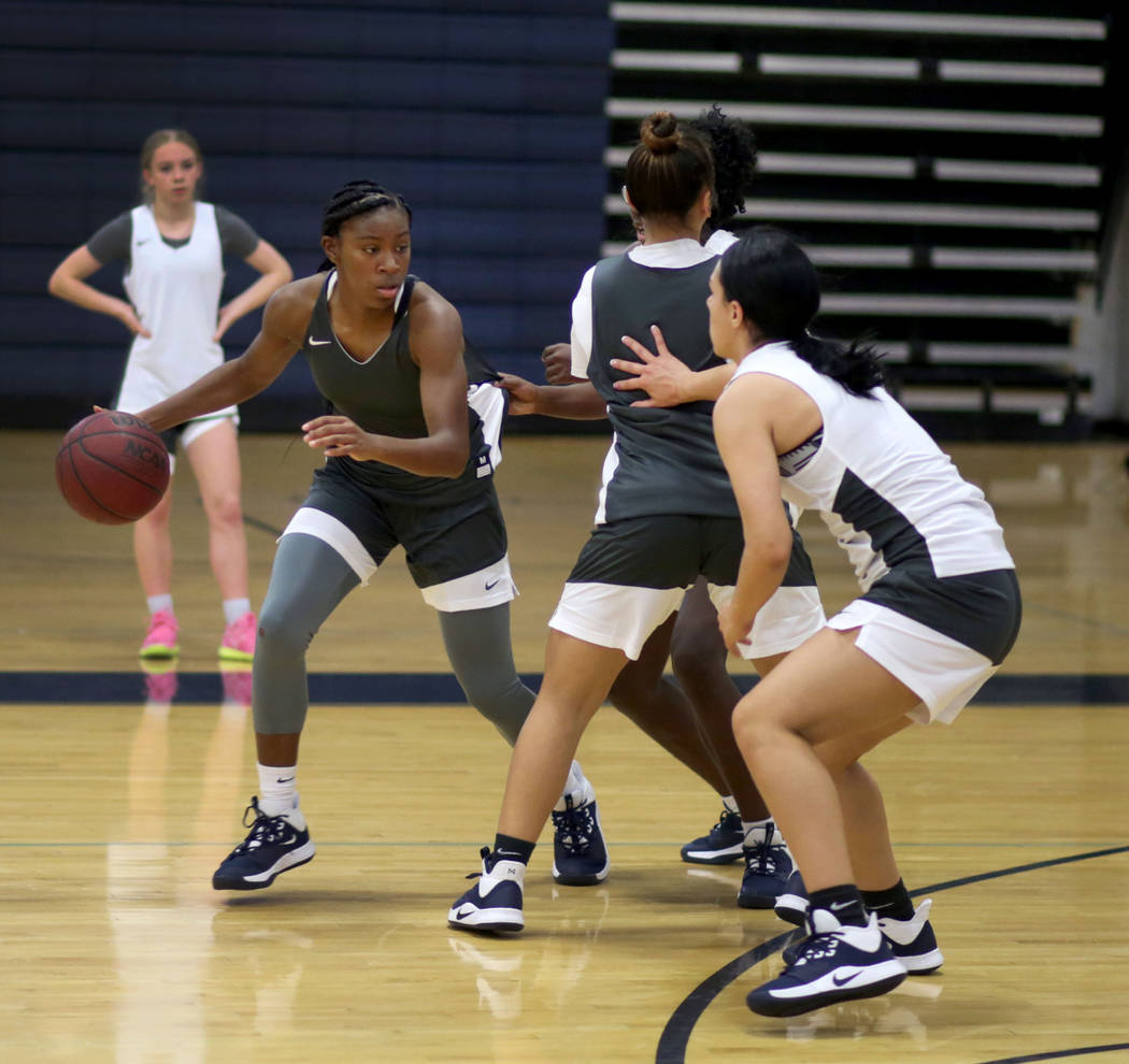 Centennial senior TeiOnni McDaniel, dribbles the ball in a drill during varsity girls practice ...