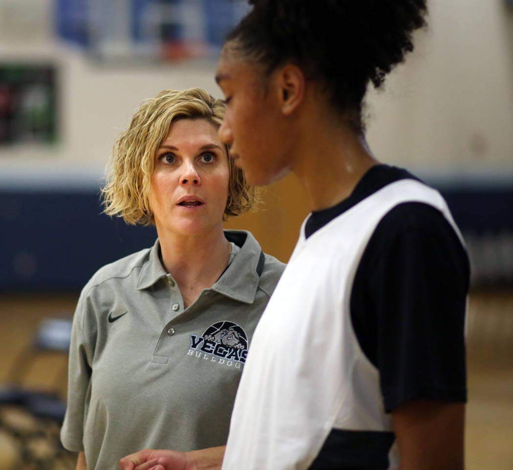 Assistant coach Katie Lutman, left, speaks to senior Aishah Brown during practice drills at Cen ...
