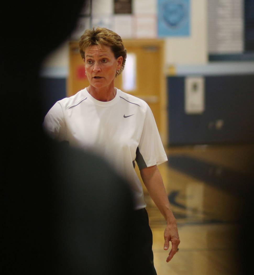 Centennial's head coach Karen Weitz speaks with the varsity girls team during practice at Cente ...