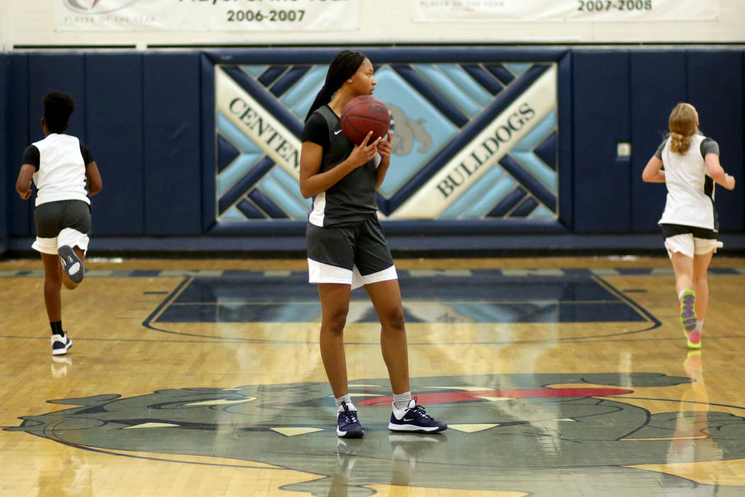 Centennial junior Taylor Bigby, center, holds the ball after beating her teammates in a drill ...