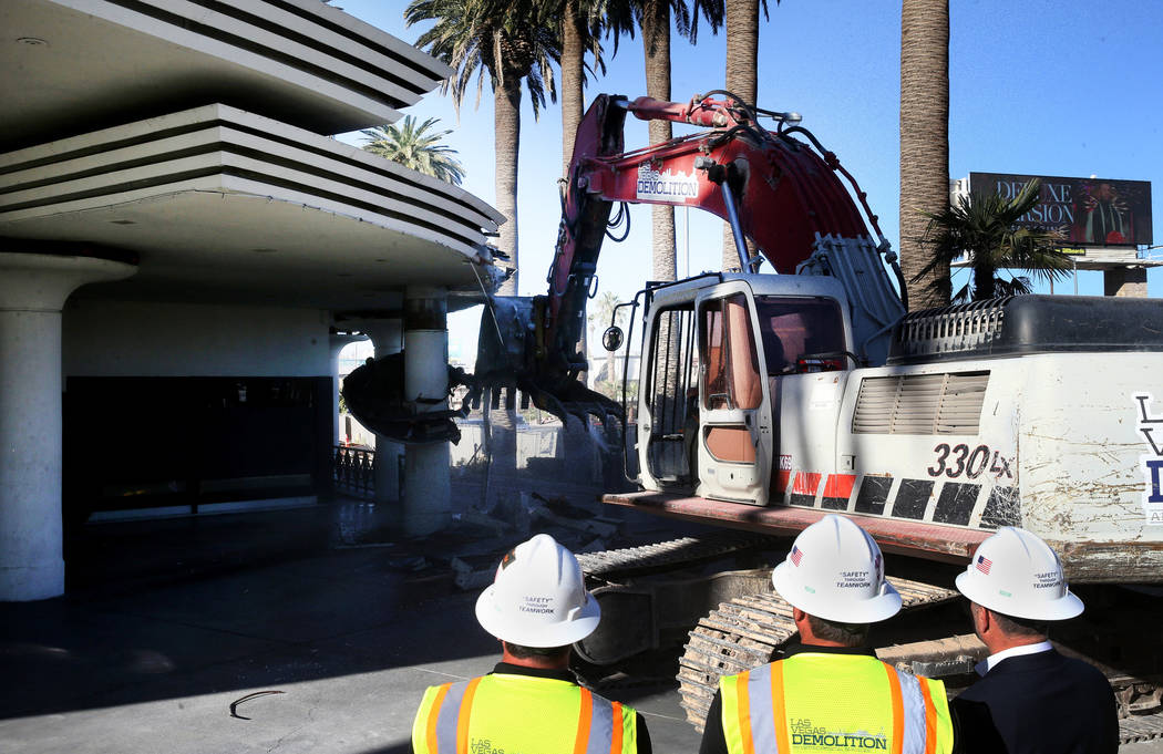 Crews from Las Vegas Demolition and Environmental Services demolish the Hard Rock Cafe in Las V ...