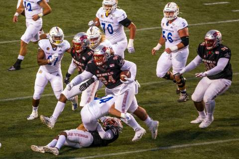 UNLV Rebels defensive lineman Kolo Uasike (94) runs back a game-winning interception late versu ...