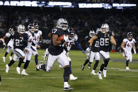 Oakland Raiders' Dwayne Harris (17) returns a punt for a touchdown against the Denver Broncos d ...
