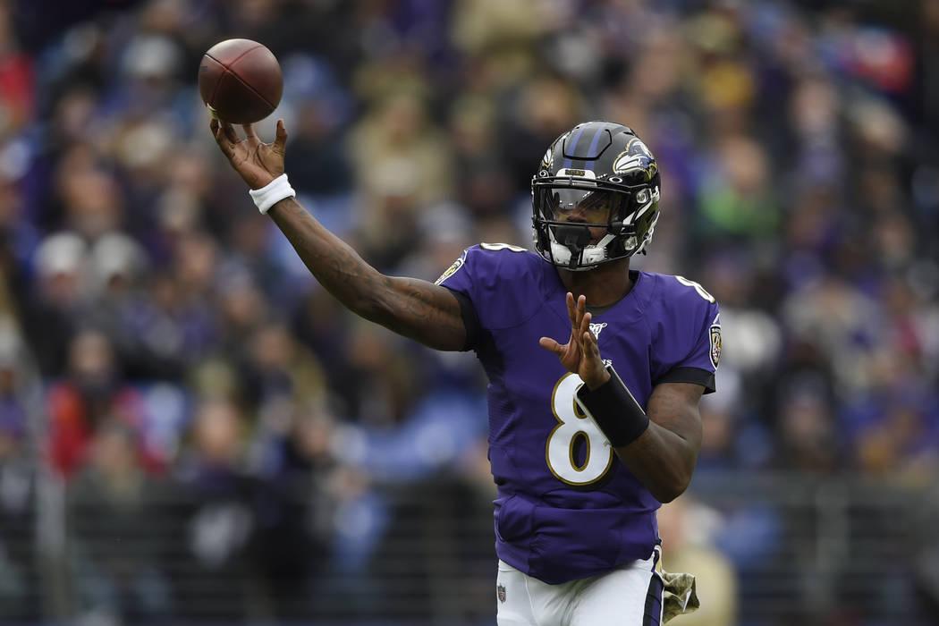 Baltimore Ravens quarterback Lamar Jackson throws a pass against the Houston Texans during the ...