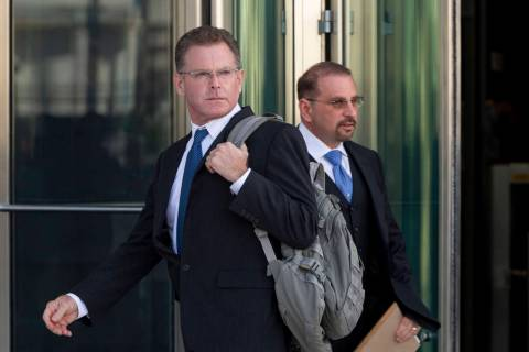 Douglas Haig, left, and his attorney Marc Victor leave the Lloyd George U.S. Courthouse after H ...