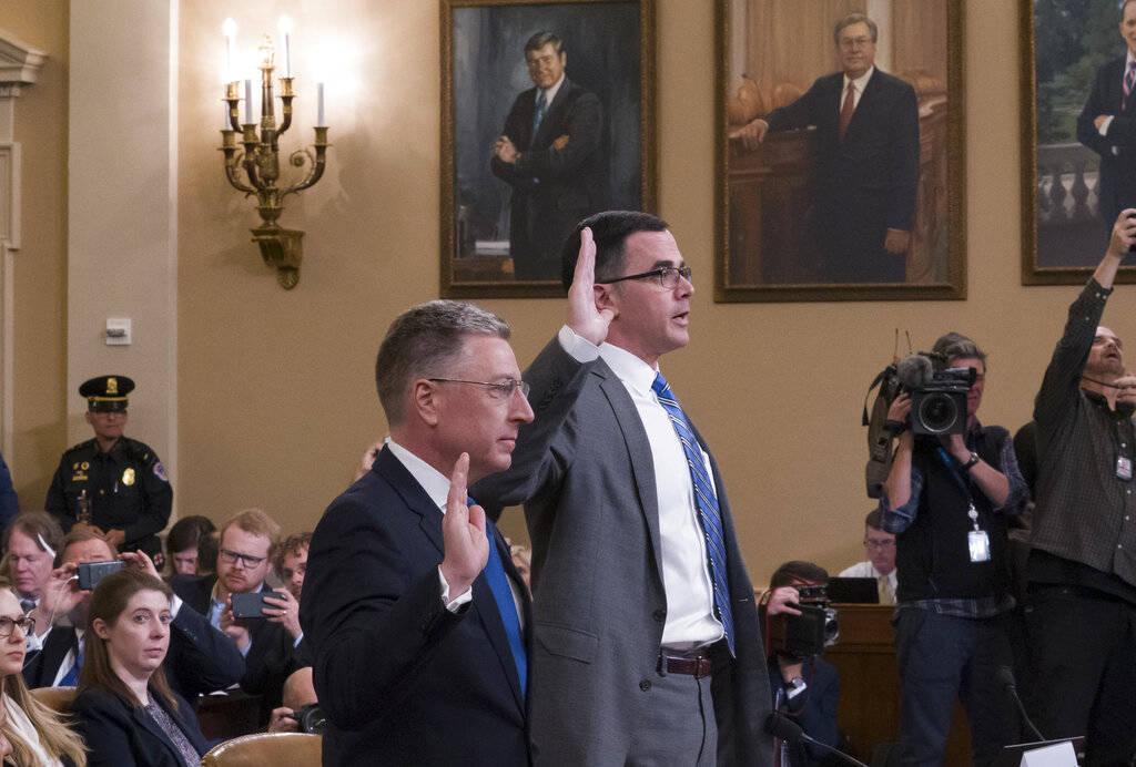 Ambassador Kurt Volker, left, former special envoy to Ukraine, and Tim Morrison, a former offic ...