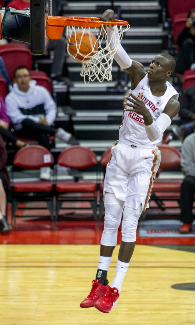 UNLV Rebels forward Mbacke Diong (34) dunks the ball over the Abilene Christian Wildcats defens ...