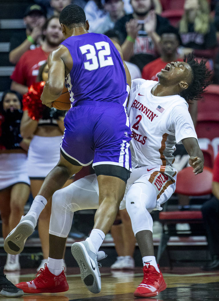 Abilene Christian Wildcats forward Joe Pleasant (32) charges into UNLV Rebels forward Donnie Ti ...