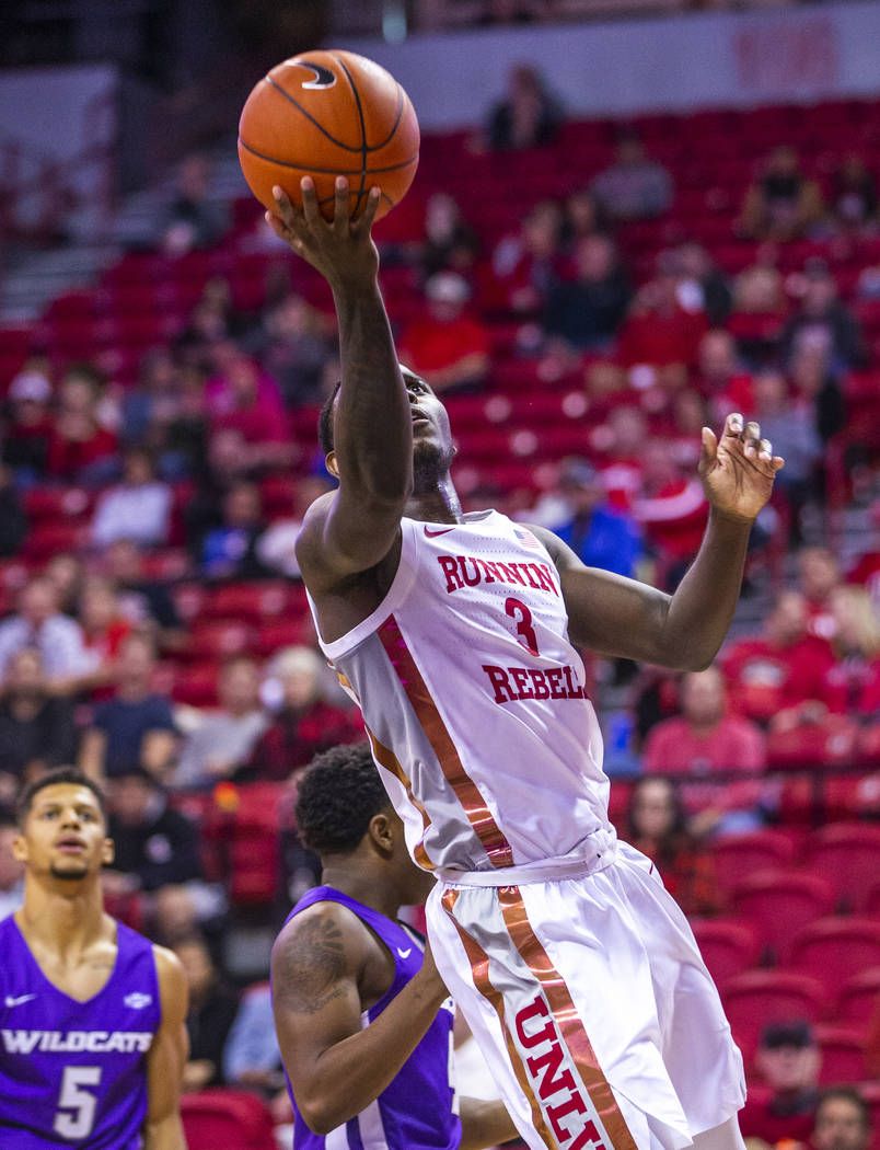 UNLV Rebels guard Amauri Hardy (3) drives the lane for a lay up versus the Abilene Christian Wi ...