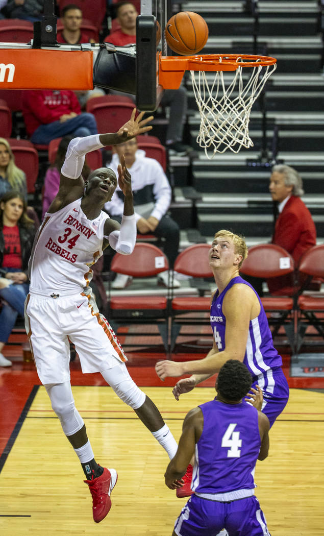 UNLV Rebels forward Mbacke Diong (34, left) touches in a basket past Abilene Christian Wildcats ...