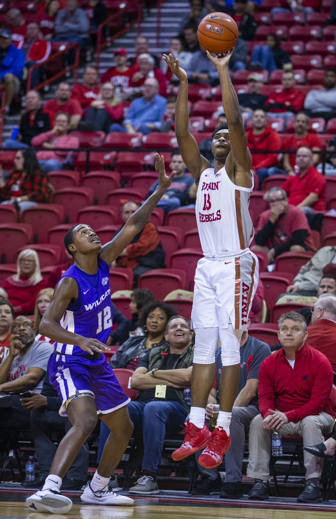 UNLV Rebels guard Bryce Hamilton (13, right) elevates for a three-point shot over Abilene Chris ...