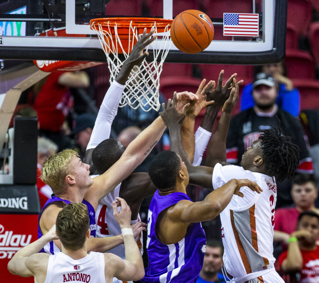 UNLV Rebels forward Donnie Tillman (2, right) battles for a rebound under the basket with Abile ...