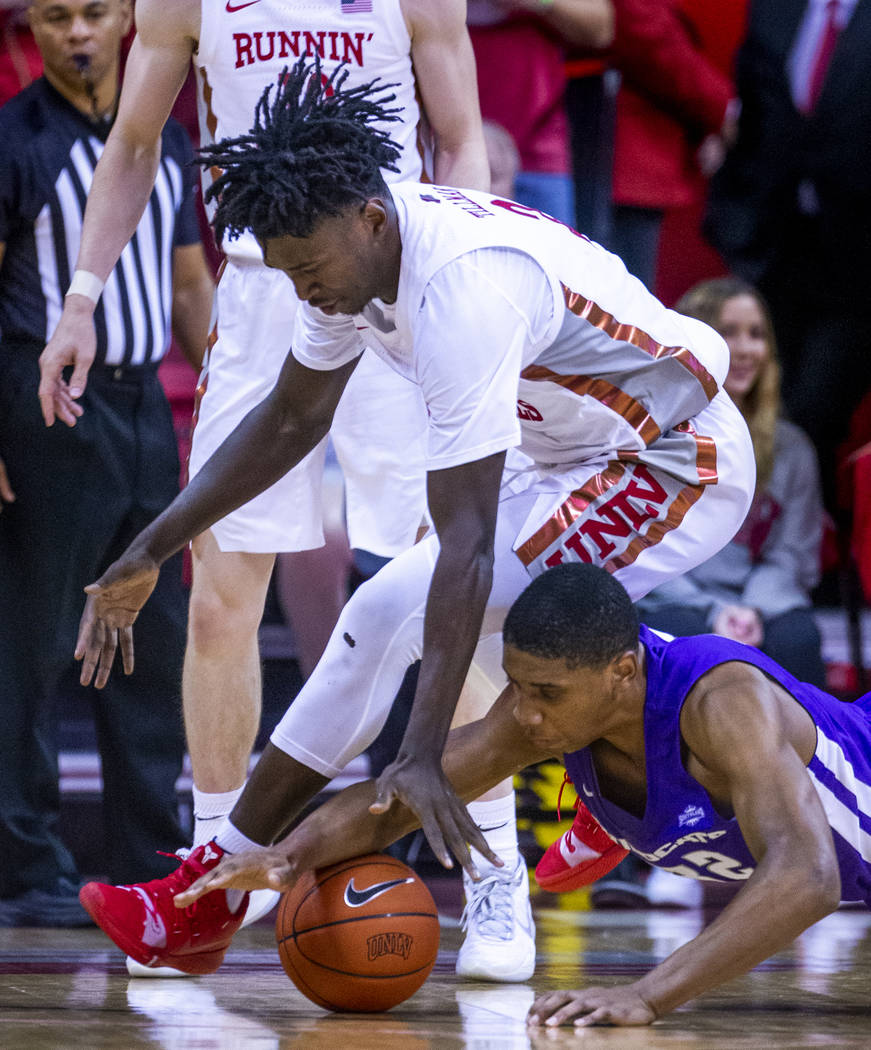 UNLV Rebels forward Donnie Tillman (2, above) battles for a loose ball on the court with Abilen ...