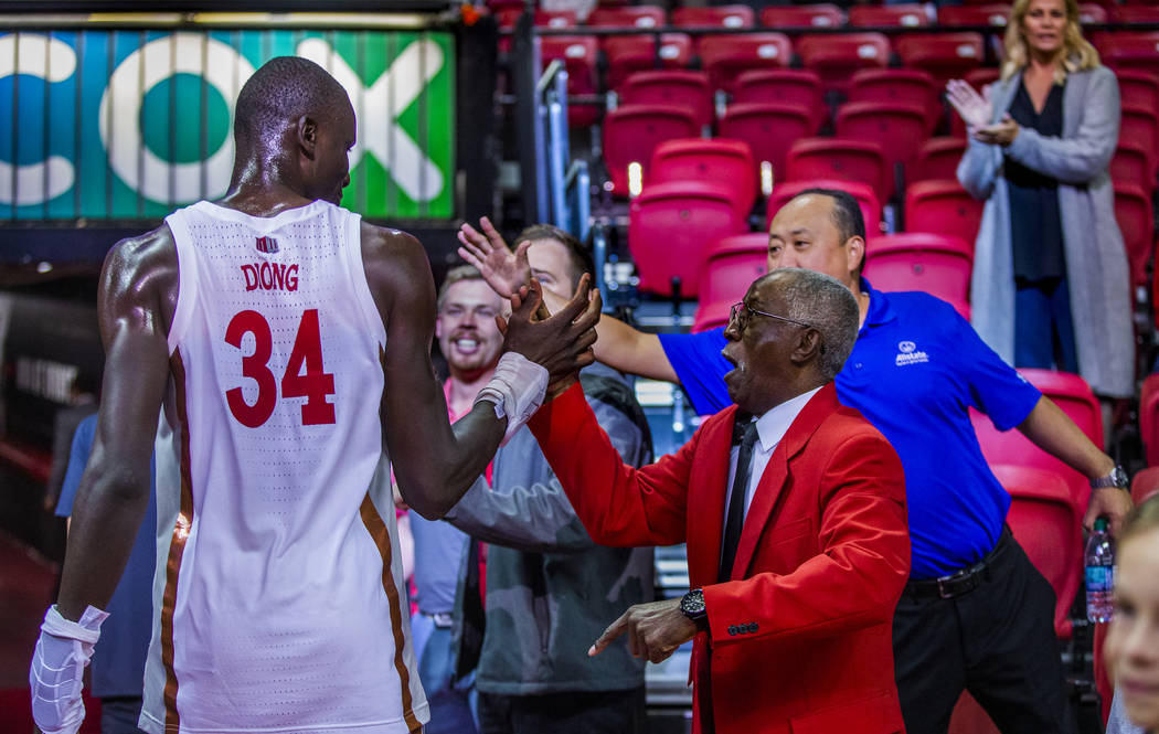 UNLV Rebels forward Mbacke Diong (34) is congratulated by security staff and fans after the win ...