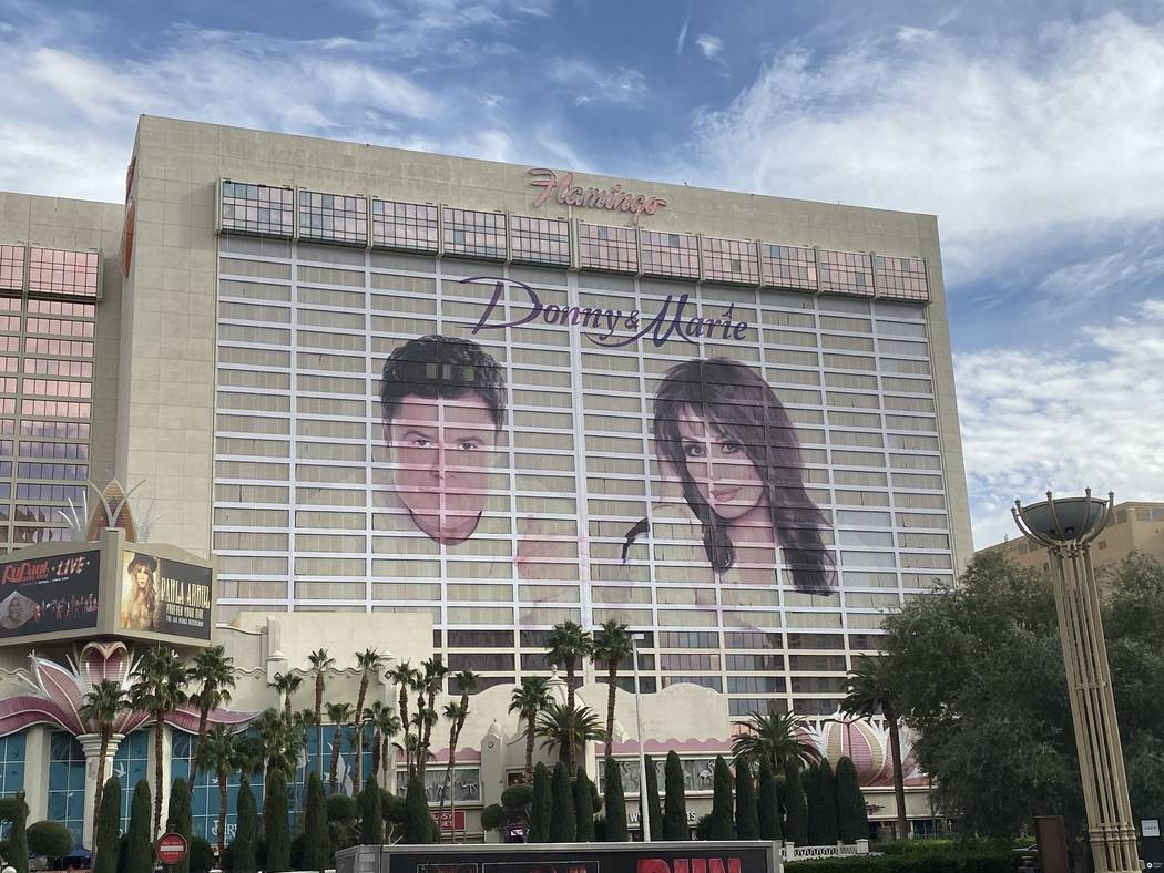 The famed Flamingo Donny & Marie building wrap is shown overlooking the Strip on Tuesday, Nov. ...