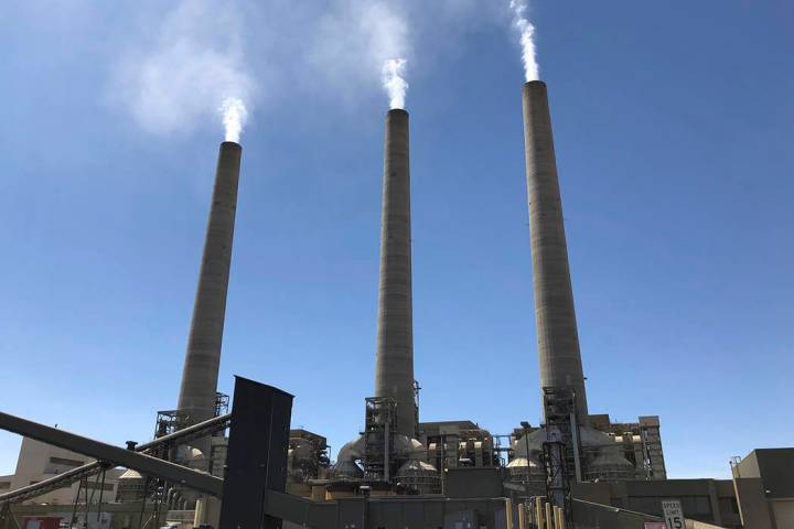 This Aug. 20, 2019, image shows a trio of concrete stacks at the Navajo Generating Station near ...