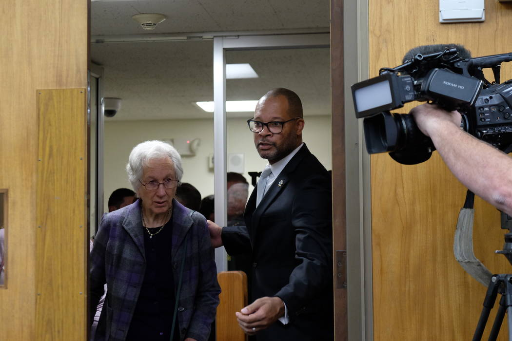 Nevada Attorney General Aaron Ford assists Cecily O'Connor, the mother of murder victim Julia W ...
