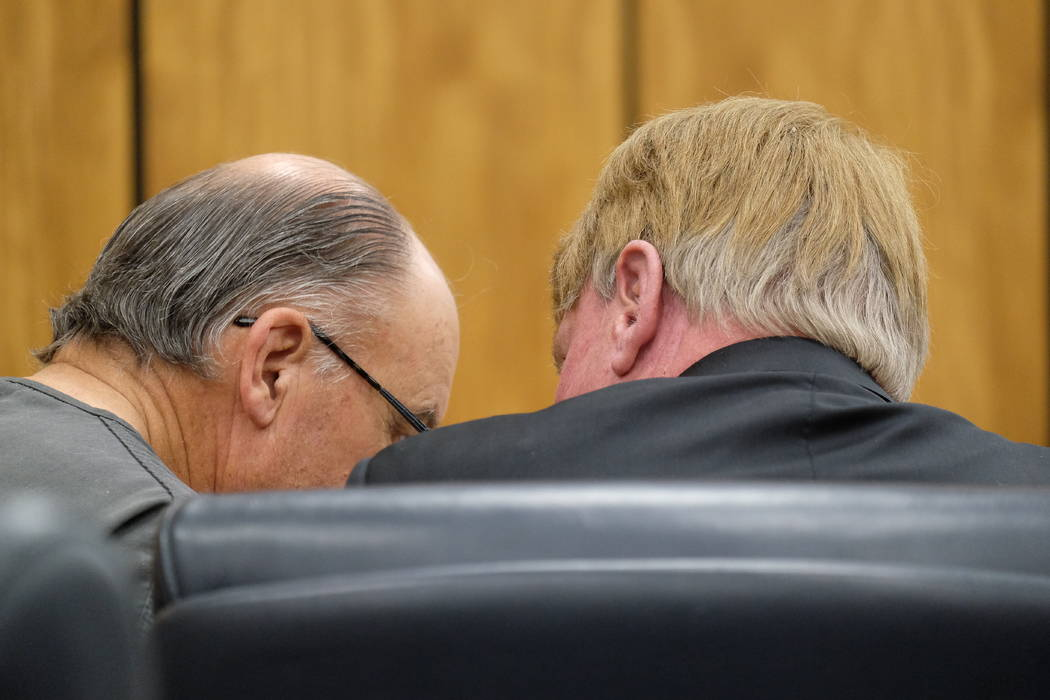 Accused killer Charles Gary Sullivan consults with attorney Dave Houston in Reno District Court ...