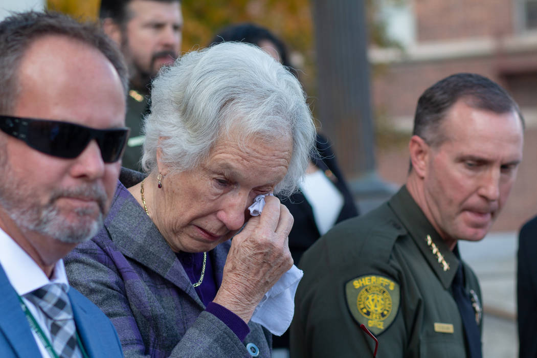 Cecily O'Connor, center, wipes away a tear during a press conference following the arraignment ...