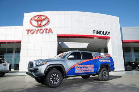 Findlay Toyota's mobile repair service department vehicle is parked in front of the dealershi ...